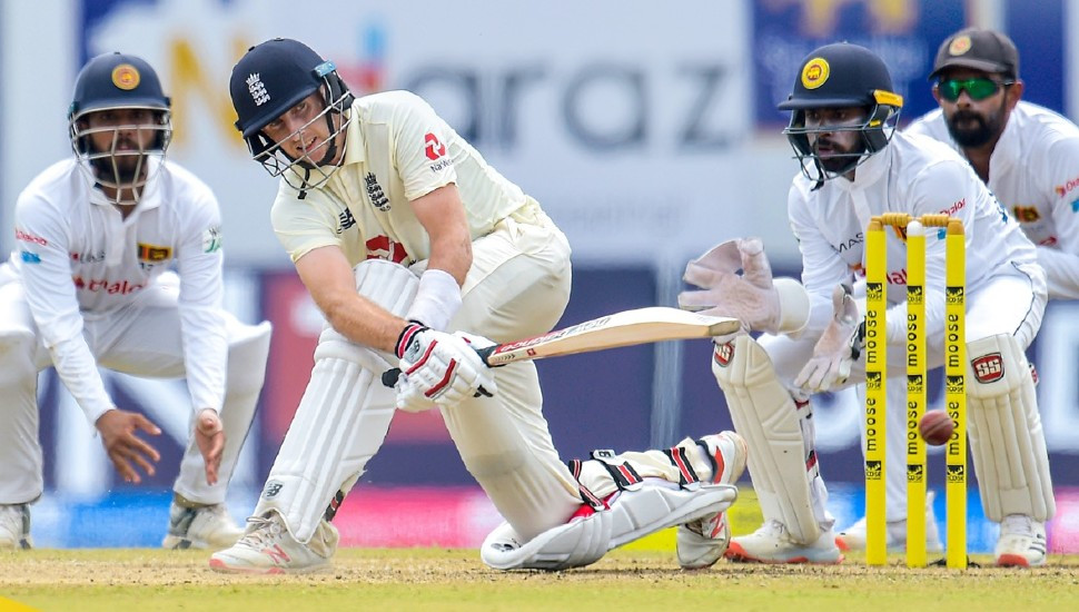 Joe Root's ton puts England firmly on top