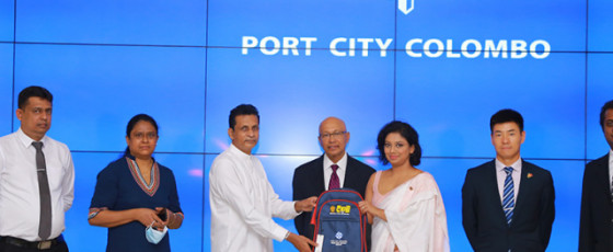 Port City Colombo donates school bags to students in Moneragala