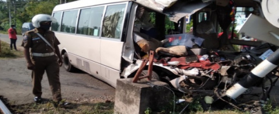 Bus carrying health workers collide with train