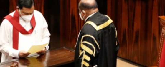 Finance Minister Basil takes oaths as an MP, sits next to Minister Pavithra
