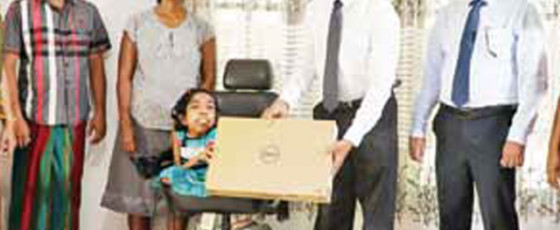 Outstanding O/L results: People's Bank presents laptop to differently-abled student